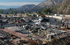 he remains of a mobile home park in Sylmar, California. 480 of the park's 600 mobile homes were burned in the Sayre Fire in November 2008. The homes in the background that did not sustain fire damage become uninhabitable due to the lack of utilities. (Photo by Michael Mancino/FEMA)