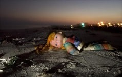 An abandoned doll lies on the beach in Gulfport, Mississippi, following Hurricane Katrina. (Photo by Carmen K. Sisson/Cloudybright)