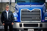 Highway Transport Chemical maintenance director Larry Edwards in front of a 2014 Mack Pinnacle truck