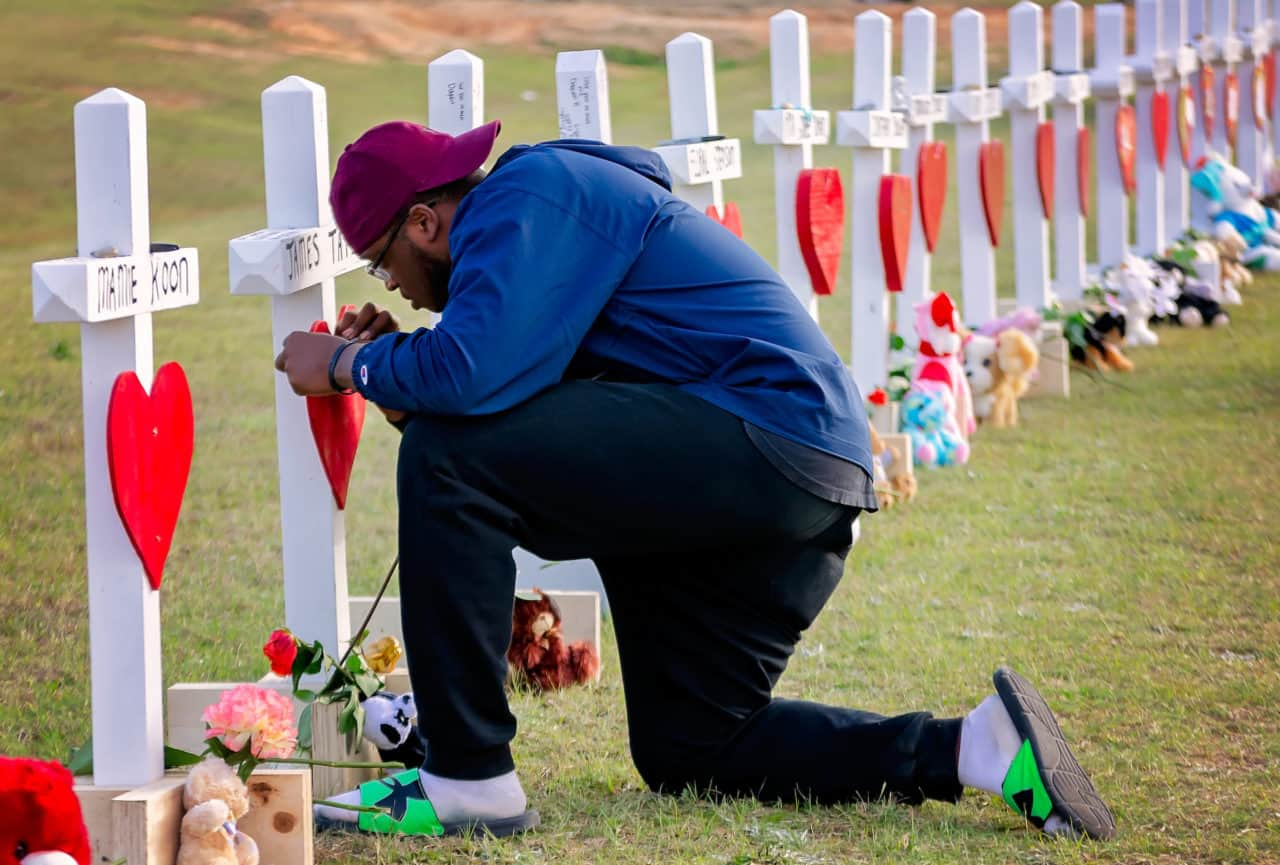 Terry Freeman leaves a message on a cross for tornado victim James Tate at Providence Baptist Church, March 7, 2019, in Opelika, Ala. Freeman was among hundreds who showed up at the church to volunteer after an EF-4 tornado ripped through the community, March 3, 2019, kiling 23 people and leaving a 70-mile long path of destruction. The tornado, one of 39 to touch down in the South that day, was the most deadly tornado to occur in the U.S. since 2013. (Photo by Carmen K. Sisson/Cloudybright)