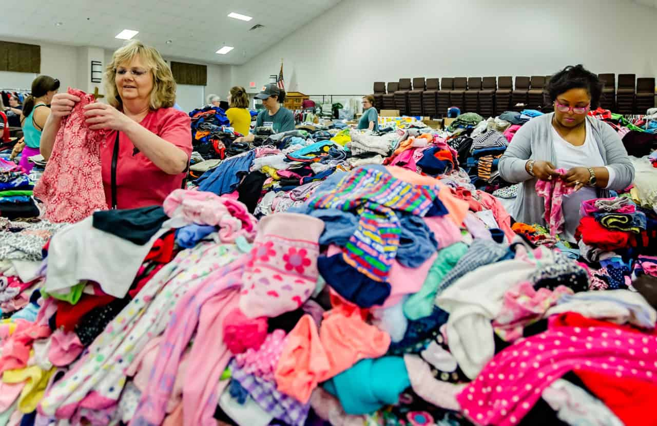 Cheryl Key and Gwen Shaver sort baby clothes at Providence Baptist Church, March 7, 2019, in Opelika, Ala. The women were among hundreds who showed up at the church to volunteer. (Photo by Carmen K. Sisson/Cloudybright)