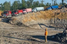 Keith Radford, owner of KR Trucking, watches as his fleet of Mack Granite dump trucks head into a clay pit, Sept. 20, 2016, in Huntingdon, Tenn. The company, which mines both kaolin and ball clay, uses primarily Mack Granites in its fleet. (Photo by Carmen K. Sisson/Cloudybright)